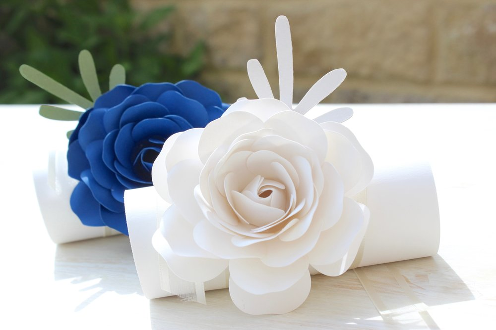 Royal blue and white paper flower corsage