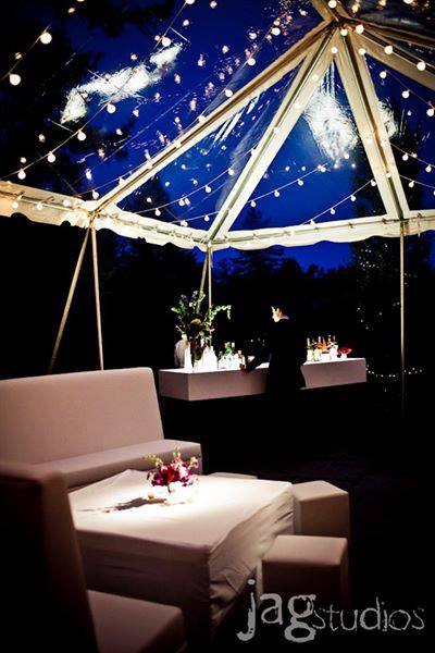 Clear-top tent, bistro lighting, lighted bar and lounge furniture.  Photo by Jag Studios.