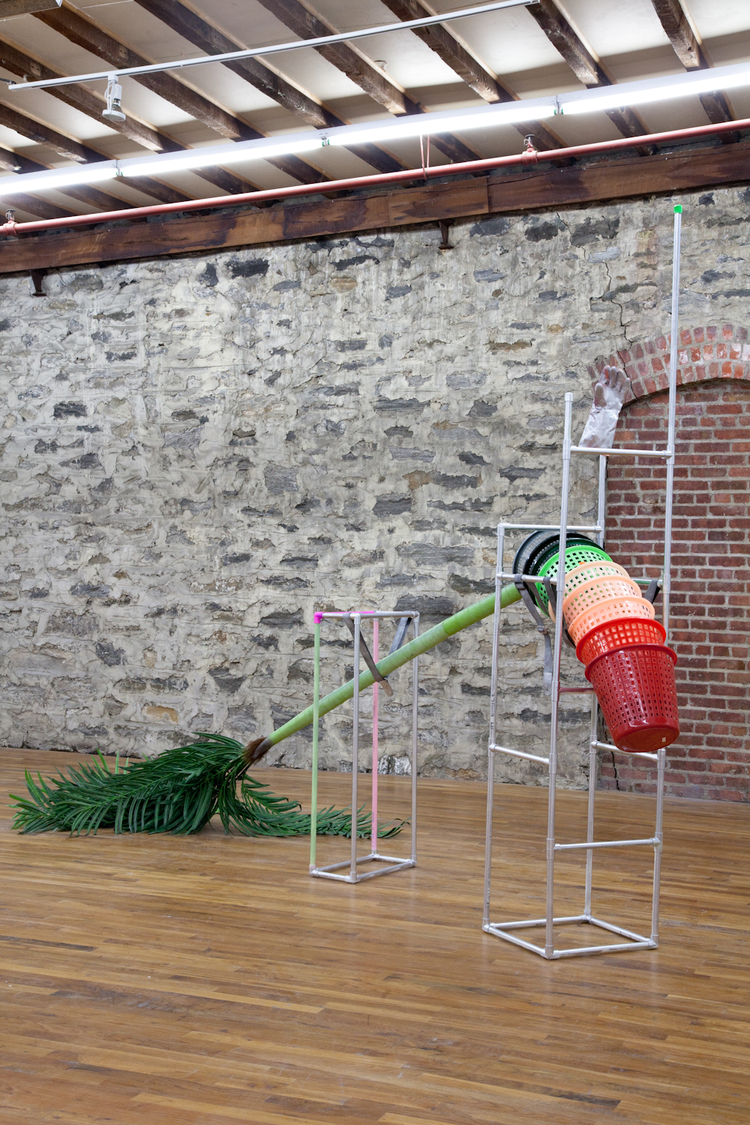The Loping Palm 2012 PVC pipe, rubber glove, enamel, spray paint, artificial palm tree, Guitar Hero straps, aluminum foil, baskets, package tape 162 x 99 x 72 inches