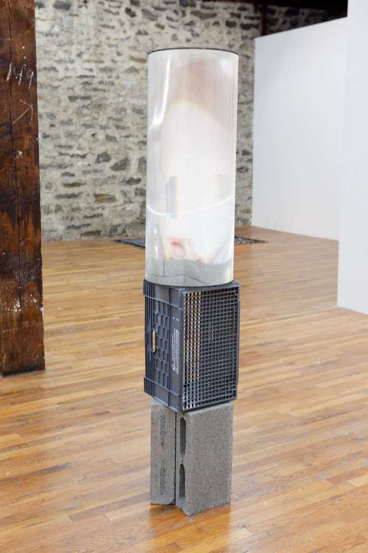 The Actual Secret of the Valley 2011 Cinderblocks, plastic crate, bricks, melted candle, and Fresnel Lens 65 x 12 x 12 inches