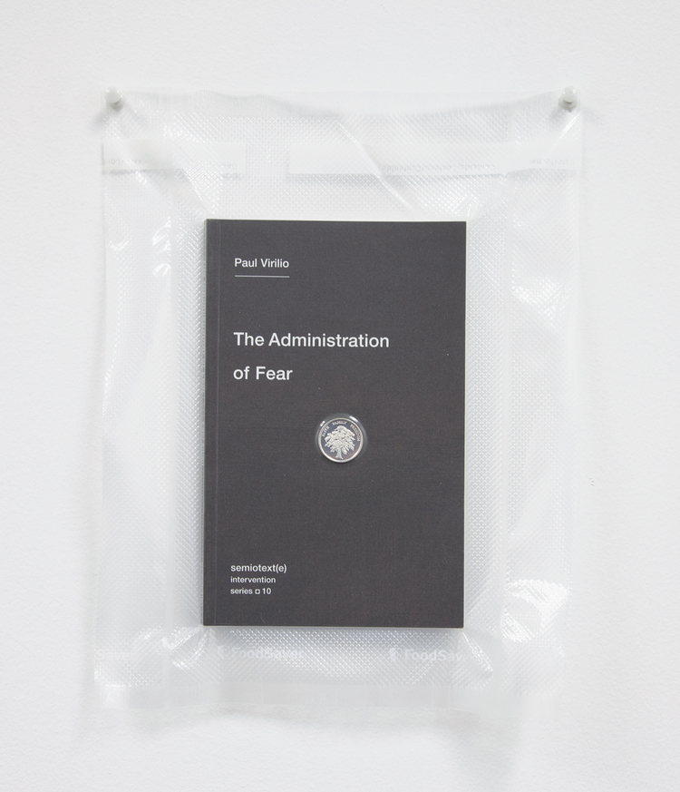 Brad Troemel  TSA No Fly List Vacuum Sealed Paul Virilio -'The Administration of Fear' with AOCS Solid Silver Prosperity Treet coin, 2013 10 x 8 inches