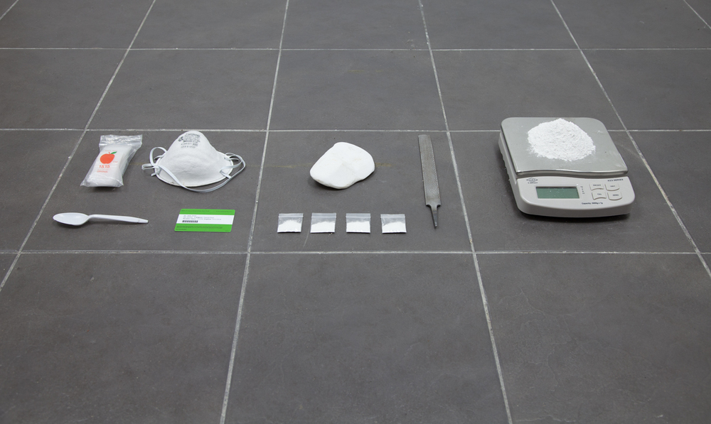 Isaac Brest This Shit Right Here, N****?!, 2013 Plastic baggies, dust mask, salvaged stone from Parthenon, metal file, salvaged stone from Parthenon filed down to powder, four plastic baggies containing one gram of Parthenon powder, Metropolitan Museum membership card, plastic spoon Dimensions variable