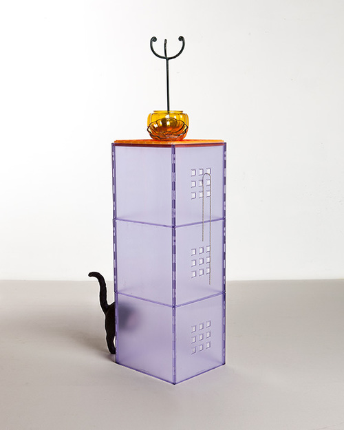Bad Luck Bobby Chain  2012 Plastic container, rubber cat, enamel, glass pumpkin, candle stand, silver chain, detergent, packaging tape, foam apple  15 x 55 x 18 inches