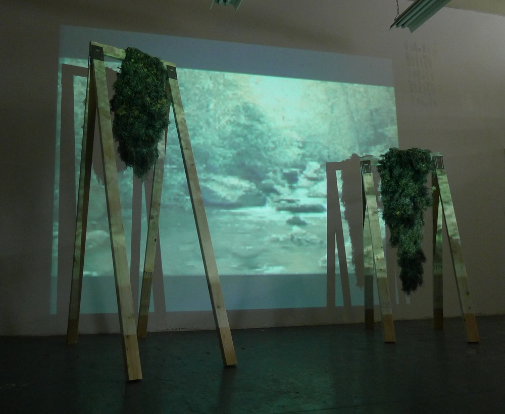Deer Bark  2011 One channel video/audio, wood, ghillie suits Dimensions variable