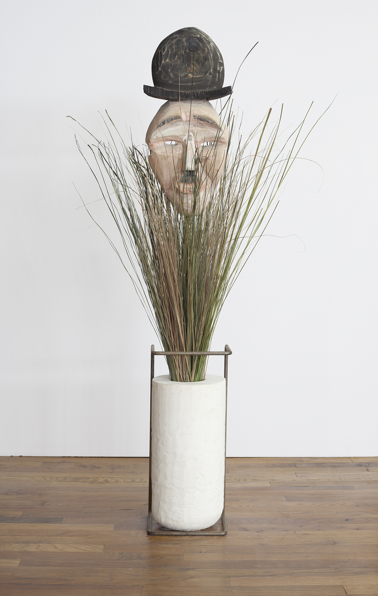 Face Off (Charlie) 2013 Wood, grass, plaster and steel Dimensions variable