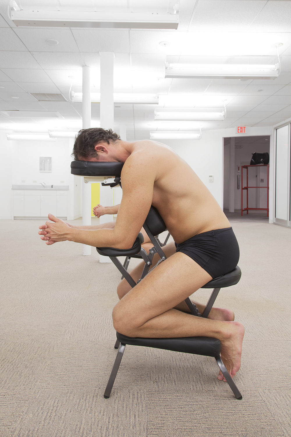 ALEX PERWEILER / ZACHARY SUSSKIND  On Relief (Cristian, South Florida) , 2013 Man on massage chair Dimensions variable