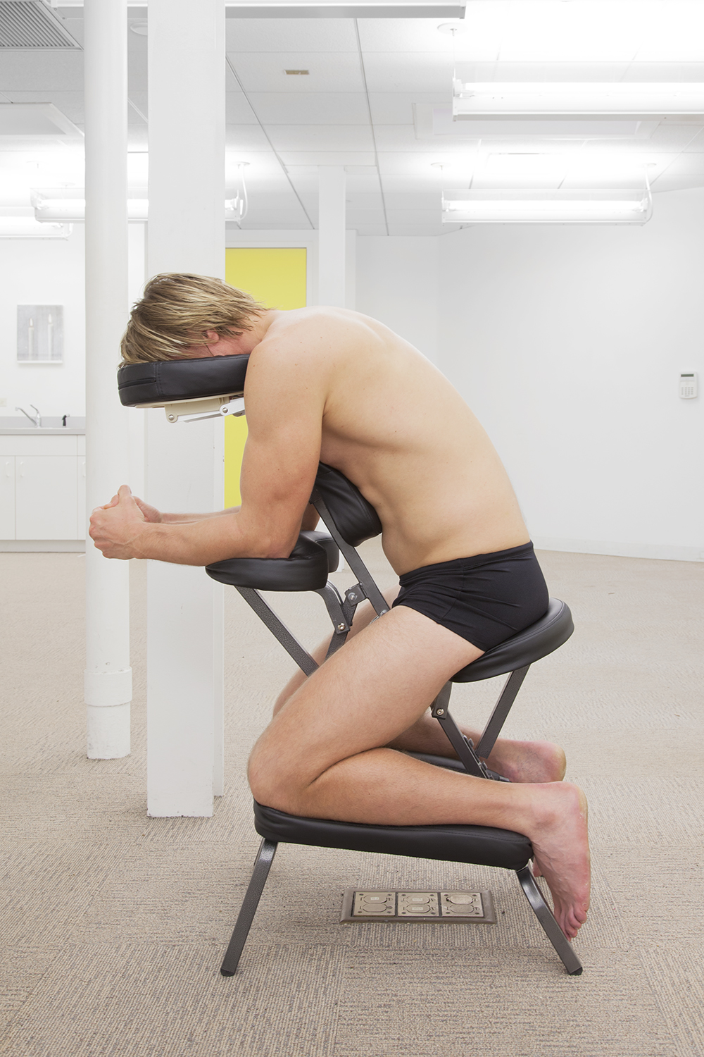ALEX PERWEILER / ZACHARY SUSSKIND On Relief (Stanislav, South Florida), 2013 Man on massage chair Dimensions variable