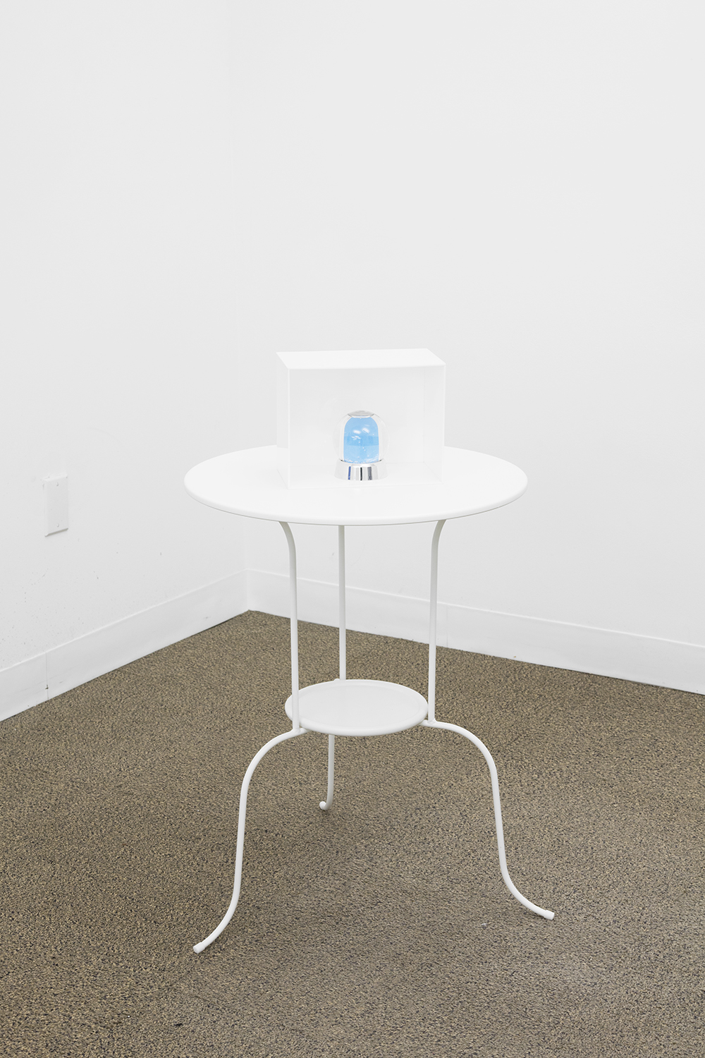 ALEX ITO  For Tolian Soran III  , 2013   Aluminum table, plexiglass, snow globe, key chain, books and inkjet print   34 x 20 x 20 inches