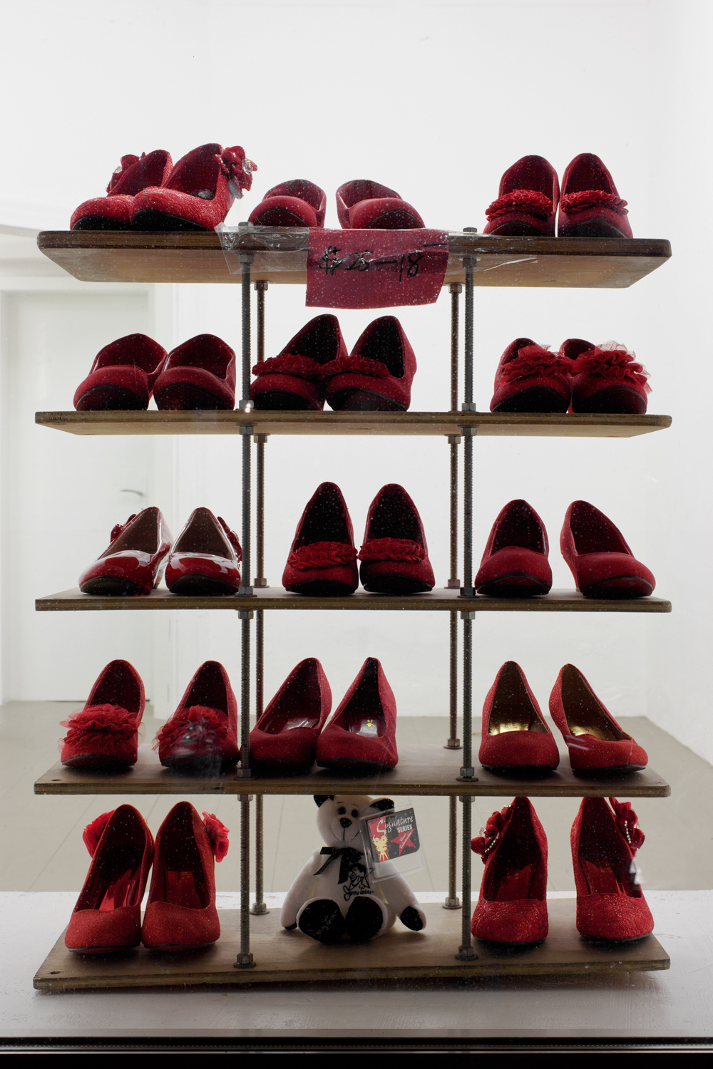 Red Shoes: Bootleg II (Resoled)   2014   Metal, wood, fabric, plastic, rubber, tape, paper, ink, glitter   Dimensions variable