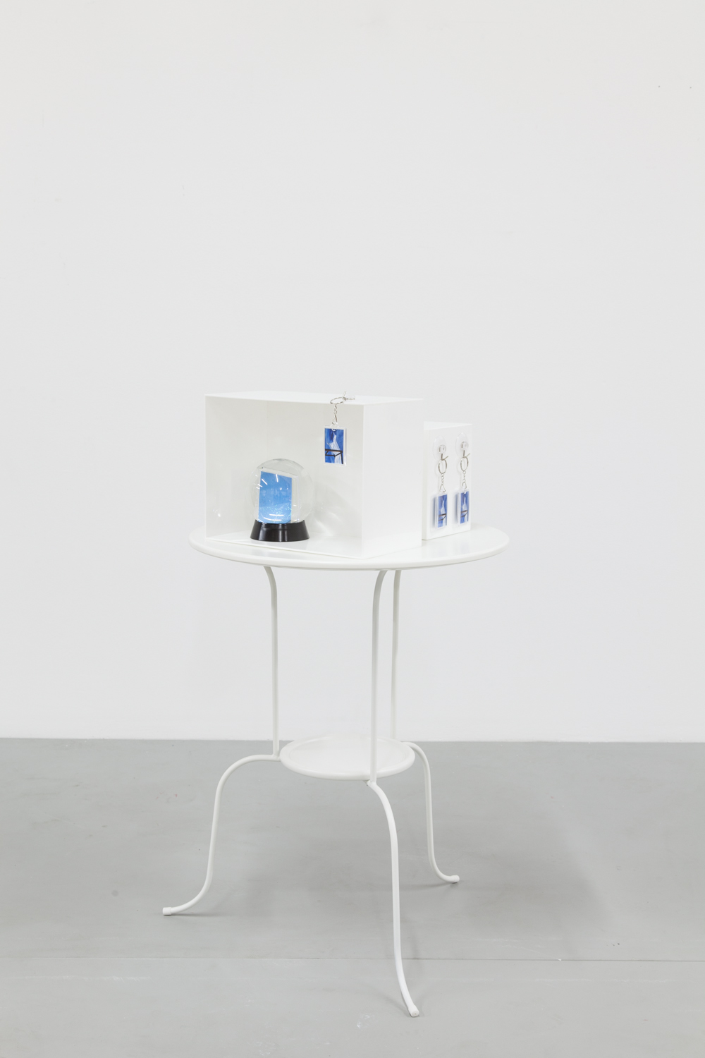 ALEX ITO   For Tolian Soran I/II  2013 Table, plexiglass, aluminum print, plaster, snowglobe, keychain and hooks 36 X 20 X 20 inches