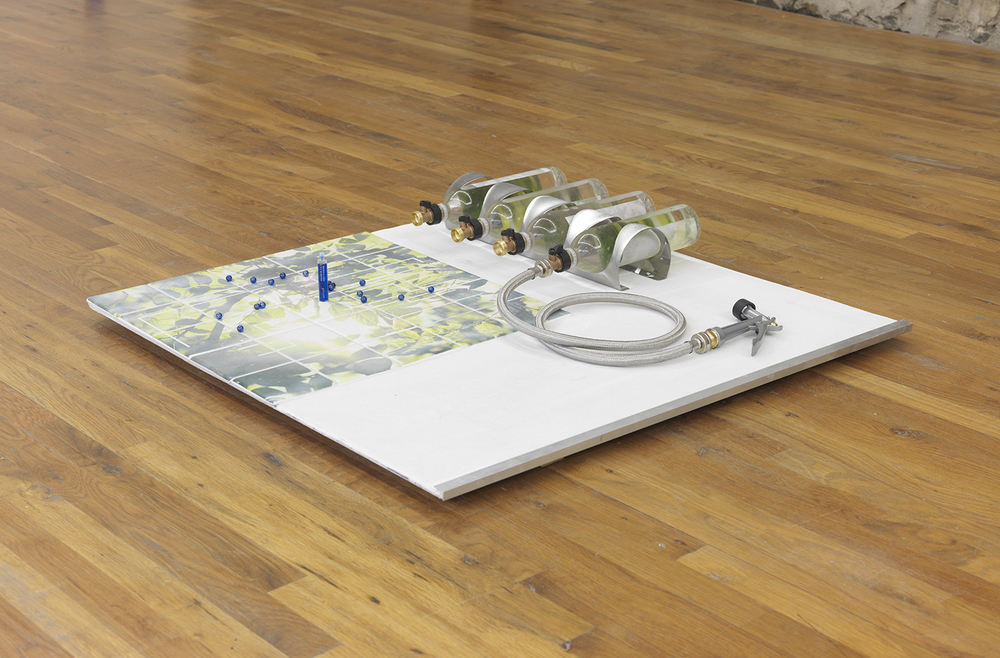 Carson Fisk-Vittori Weather options: image woman vs. image nature diagram, 2014 Ceramic tiles, concrete panel, grout, wood, inkjet transfer, aluminum angle, weather bottles, brass adapters, stainless steel hose sand spray nozzle, glass spheres, glass vial, aluzene 6 x 36 x 36 inches