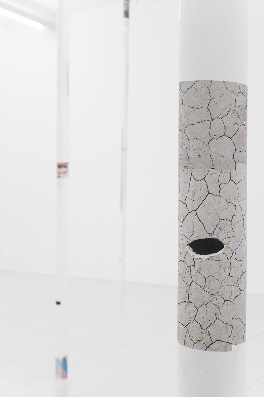 Peter Sutherland installation view PVC pipe, ink jet on perforated vinyl and enamel 144 x 3 x 3 inches each