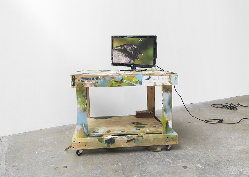 Work Makes Work (Midnight) , 2015 Artist's painting table and T.V., brick, extension cord, and still from a Bob Ross episode Dimensions variable