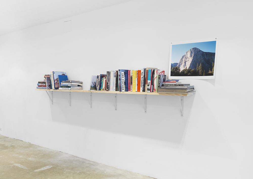 Collection of the Artist's books with photo by Sam Monkarsh