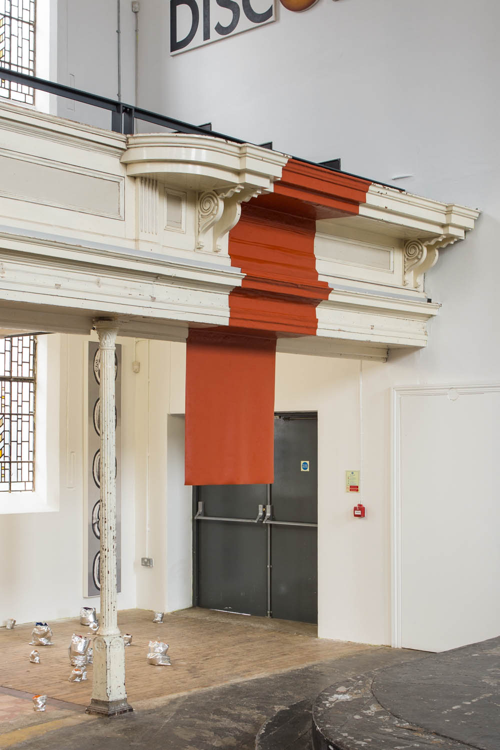 Zachary Susskind  Red Flag Act , 2015 Silicone and chapel balustrade Dimensions variable