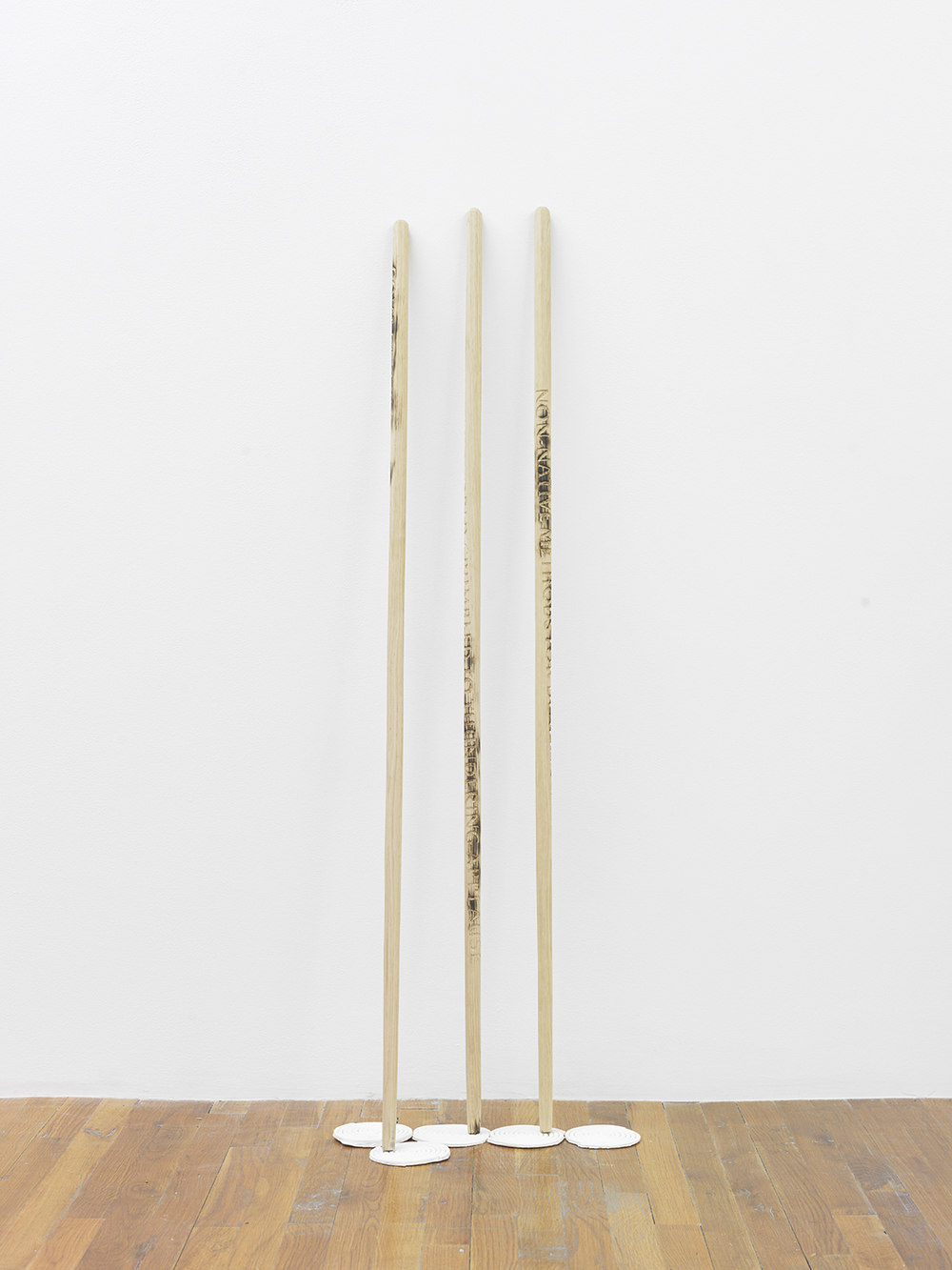 I'll still find my balance with one foot (728 things I regret burning in the fire), 2015 Engraved and seared octagonal walking sticks, gypsum  54 x 18 x 4.5 inches