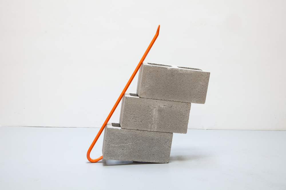 Standing Alone with Three Cinderblocks (orange) ,2013 Steel crowbar and cinderblocks 27 x 5 1/2 x 34 1/2 inches