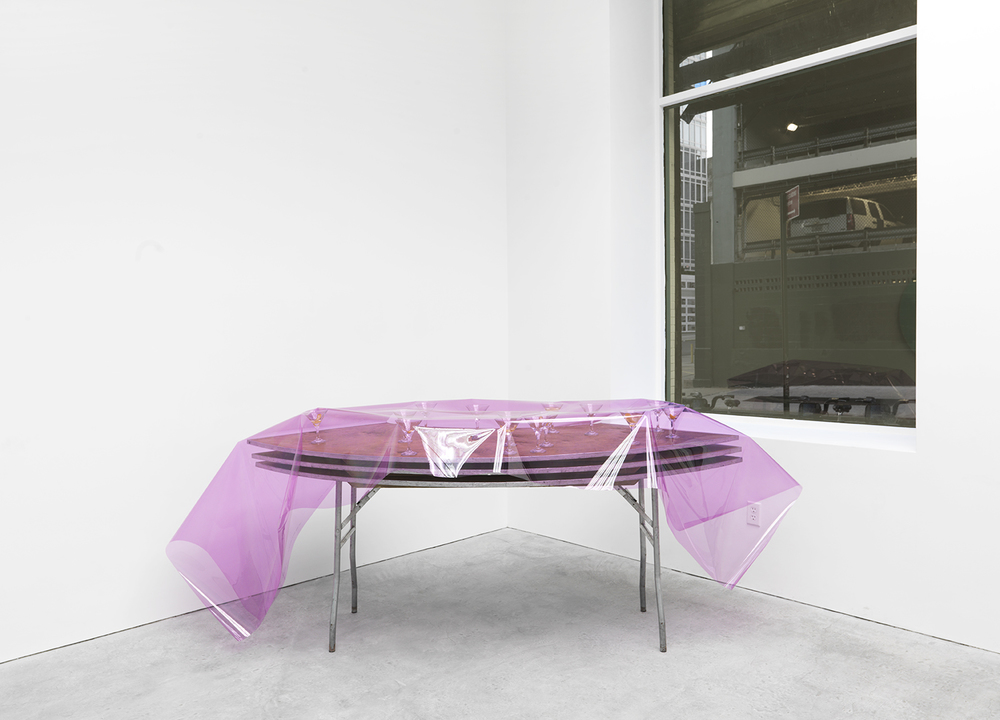 Mercenary Punch, 2015 Event hire tables and glassware, lighting film, gin, lemon rind 40 x 106 x 43 inches