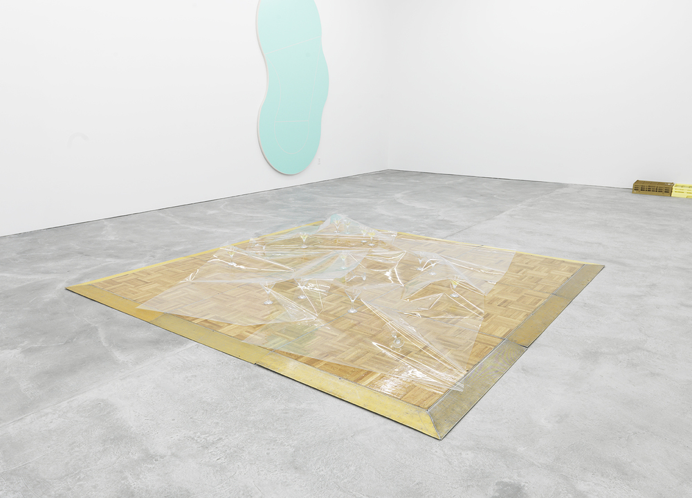 In Praise of Older Women and Other Crimes, 2015 Rental parquet floor, rental glasses, UV film, gin and rind 7 x 119 x 119 inches