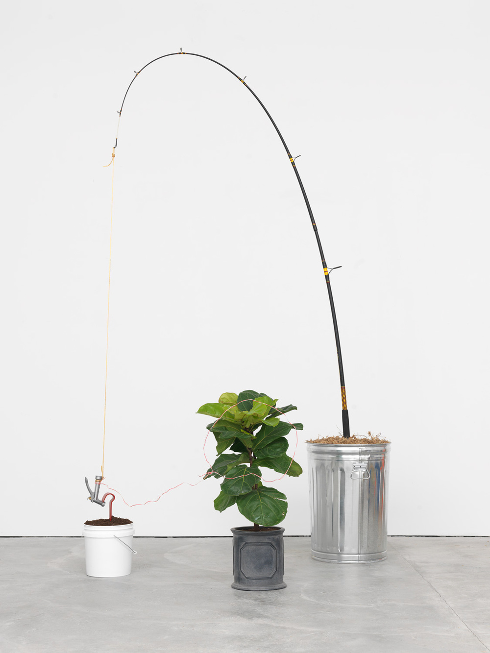 Large Game, 2015 Trash can, dry foliage, fishing pole, lamp cord, pistol grip garden hose nozzle, flat crowbar, soil, paint bucket, wire, and potted plant 99 x 64 x 64 inches