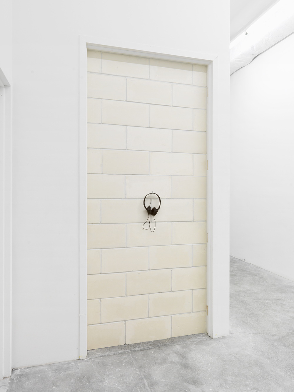 The Wall and the Confession , 2015 Plaster, joint compound, and 9-minute looped audio recording of artist's confession on headphones 96 x 42.13 inches