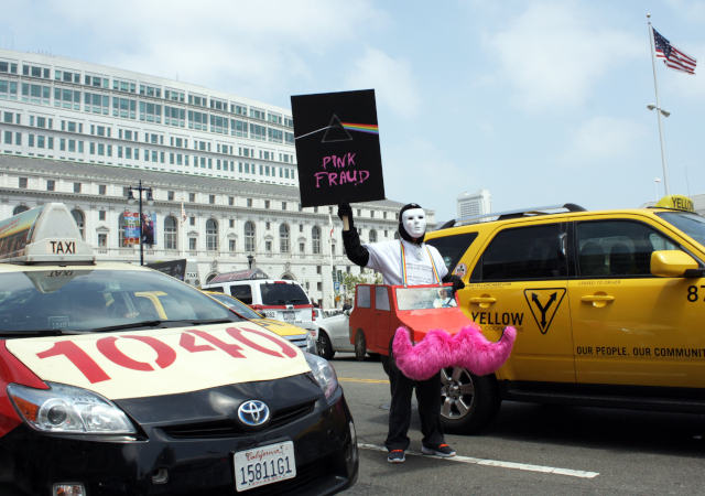 A protester at a July cab rally outside of San Francisco City Hall (KQED)