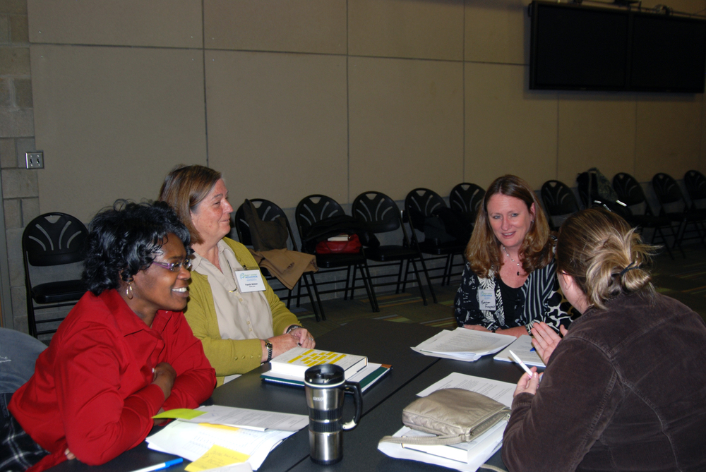 photoadvretreat11:8:14fourwomenattable.jpg