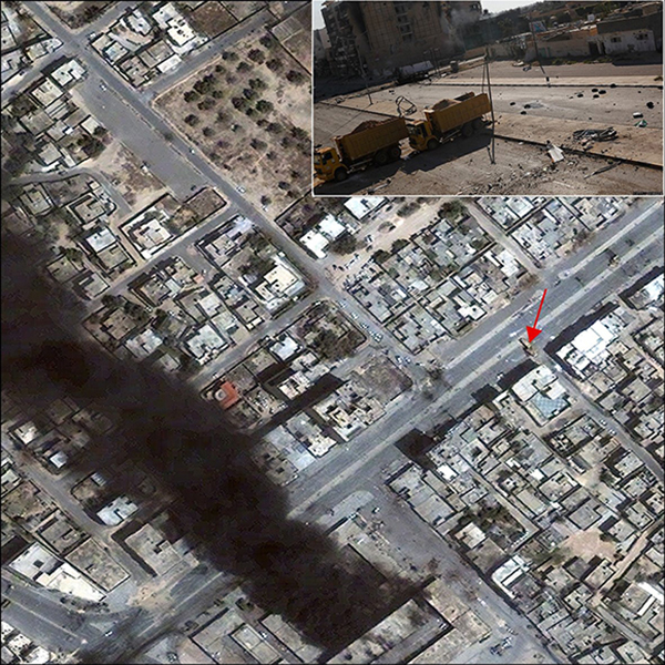 Using the UNOSAT Cybrmappr crowdsourcing application, a photograph of dump trucks used as a blockade in Misratah is precisely located in a satellite image from 23 April 2011 (see red arrow) | Courtesy of UN Institute for Training and Research, Satellite image copyright DigitalGlobe, 2012
