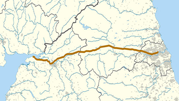 The brown line illustrates the full route of Hadrian's Wall in northern England. The background map in gray shows modern counties and urban areas. | Courtesy ofWikimedia Commons