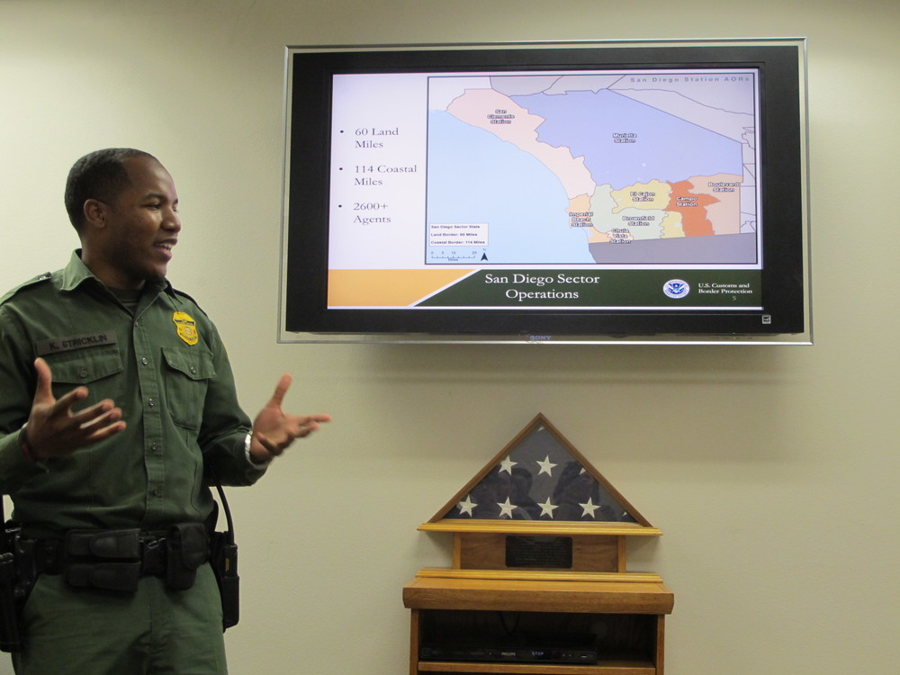 Agent Stricklin with map of the San Diego Border Patrol sector | Photo by Jena Lee
