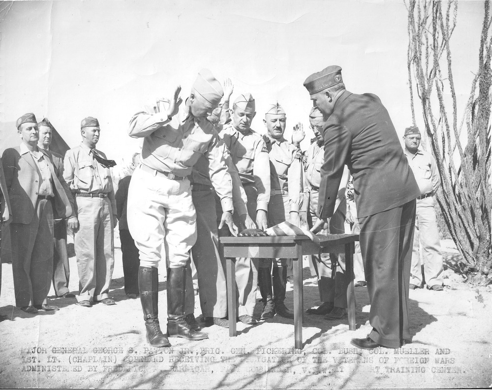 General George Patton Jr. not only picked the location of the Desert Training Center but his goals and objectives had a lasting effect on the center, though he was only there for five months. Here Patton (touching table on the left) and other officers are initiated into the Veterans of Foreign Wars at the Desert Training Center. Courtesy of the General Patton Memorial Museum.