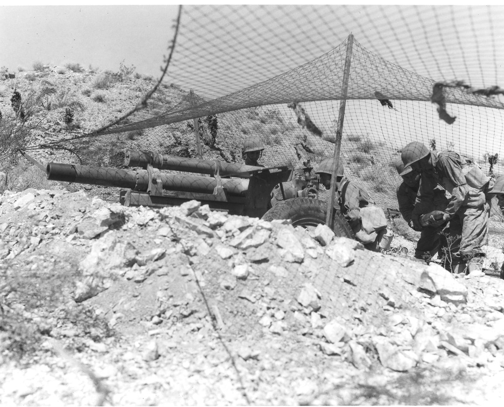 Soldiers practice with field artillery near Needles, California in September 1942. U.S. Army photograph, courtesy of the General Patton Memorial Museum.