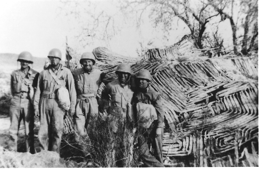 Soldiers pose near a camouflaged tank at the Desert Training Center. Training allowed the army to better understand desert conditions and how to camouflage their equipment and men in sandy landscapes with sparse vegetation. Courtesy of the General Patton Memorial Museum.