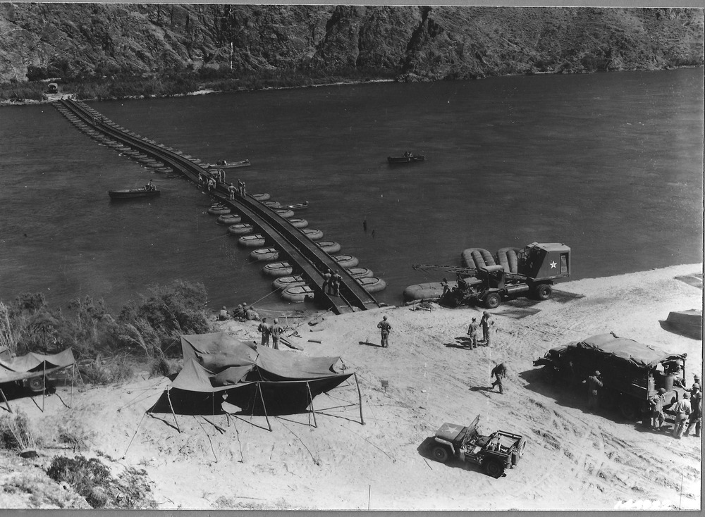 The varied terrain of training grounds allowed for troops to practice their specialty in landscapes similar to those encountered abroad. Here army engineers practice constructing pontoon bridges across the Colorado River. Courtesy of the General Patton Memorial Museum.