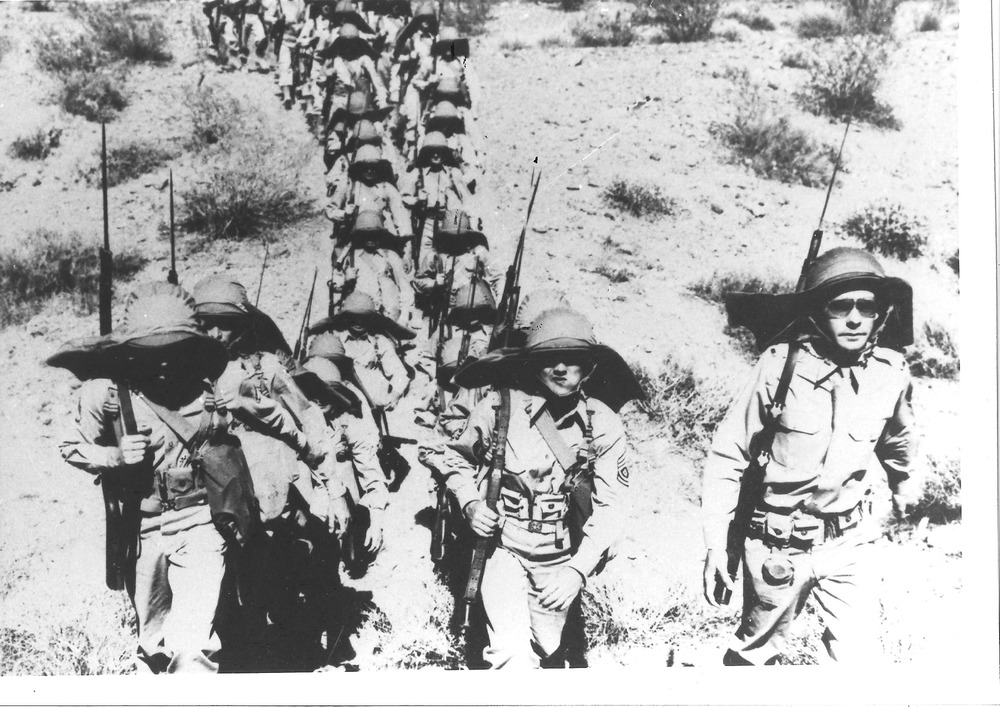 Troops march through the landscapes of the Desert Training Center. Photo by Bill Threatt, courtesy of the General Patton Memorial Museum