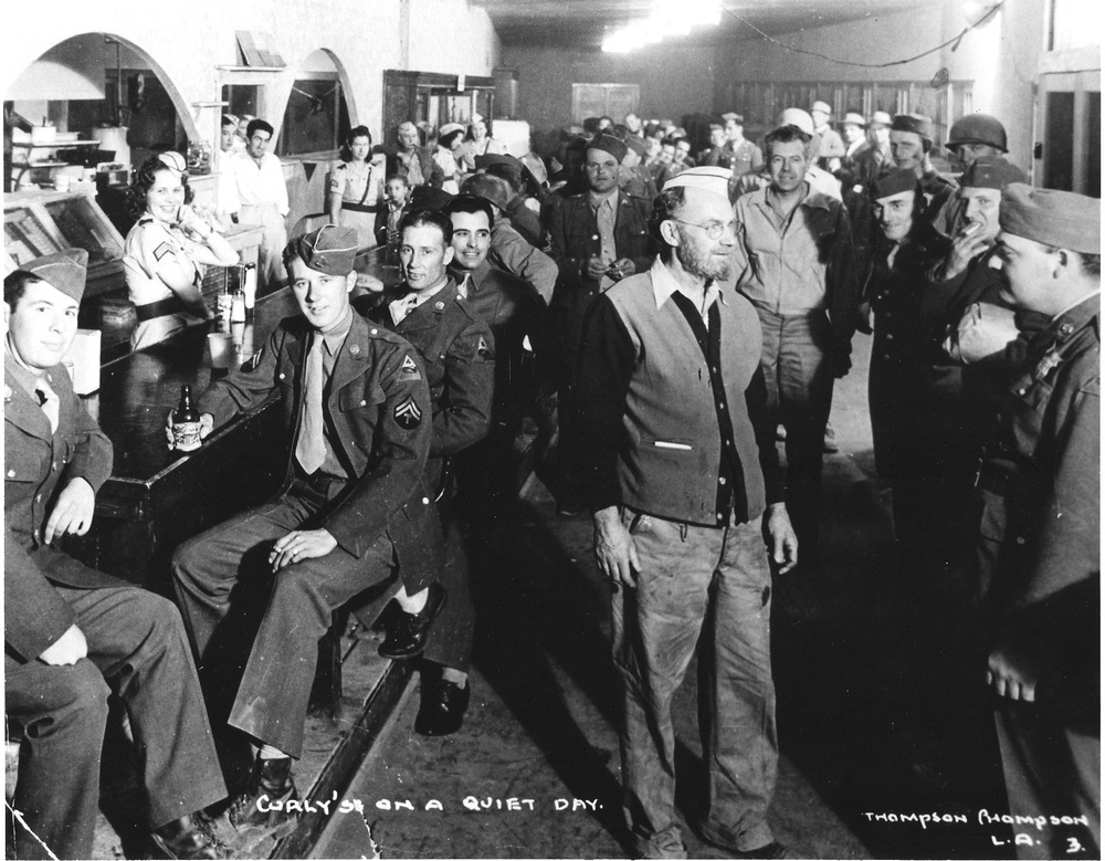 Curley's Bar in Rice, California full of soldiers from the Desert Training Center. An influx of soldiers drastically impacted local communities; while business increased, price gouging affected troops and locals alike. Thompson photograph, courtesy of the General Patton Memorial Museum.