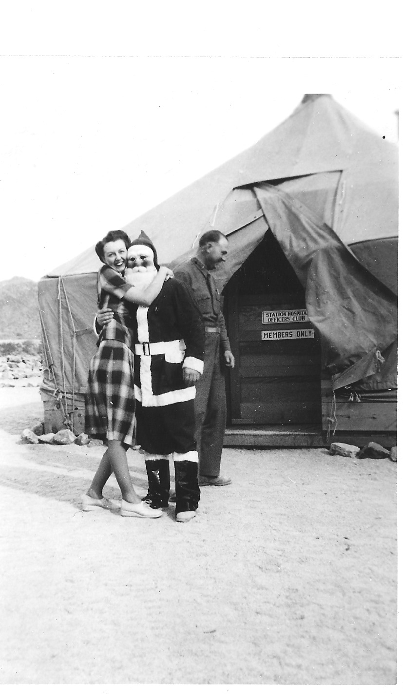 Patton initially refused women at the DTC, preferring that soldiers focus solely on training. Eventually, women worked as nurses and secretaries, especially at the DTC's Camp Young Headquarters. Here a nurse from the Camp Young Station Hospital poses on the left. To the right a woman hugs Santa outside of the Station Hospital's Officer's Club. Courtesy of the General Patton Memorial Museum.
