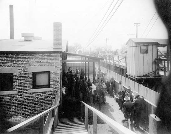 Mexicans quarantined at the Santa Fe Bridge Disinfection Plant, 1917 | USPHS, National Archives