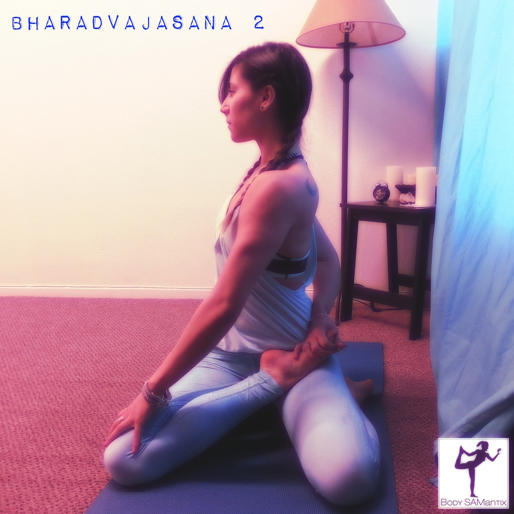 This variation is a bound twist. One leg is in half padamasana (lotus) and the arm is wrapping around to grab the foot. This bind also helps to open up the shoulders as well.