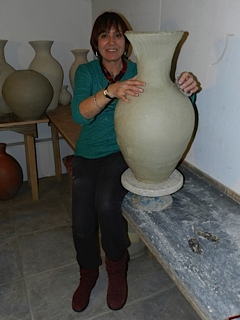 Jane Yates working on a 'leather hard' pot
