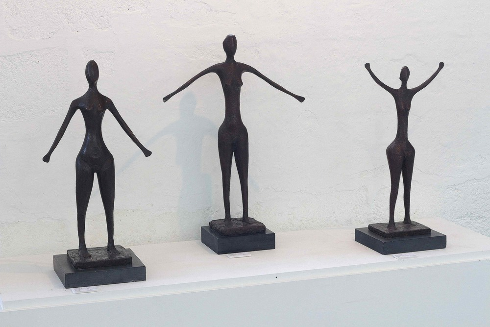Left to right:  Figure with Arms Down II  Bronze. Edition of 5, 2/5  2004  £13,000     Figure with Arms Down I  Bronze. Edition of 5, 1/5  2004  £13,500     Figure with Arms Up  Bronze. Edition of 5, 2/5  2004  £12,500