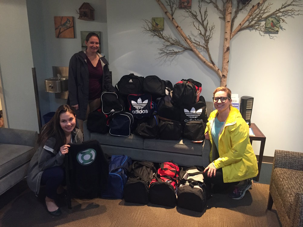 Duffle bags filled with brand new clothes and shoes for the kids at Ryther Child Center.