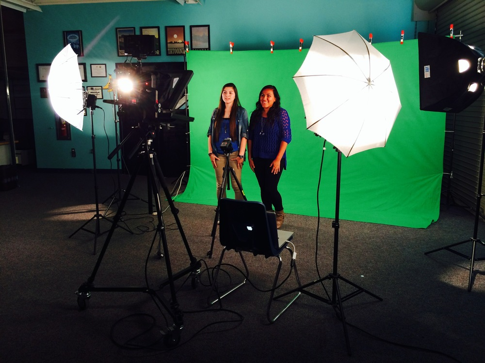 Clarissa Cisneros and Zaira Garcia shoot an episode of Behind the Blue.