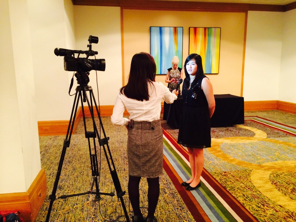 DATA Junior Bonnie Vo being interviewed by Gitzel Puenta from KMIR 6