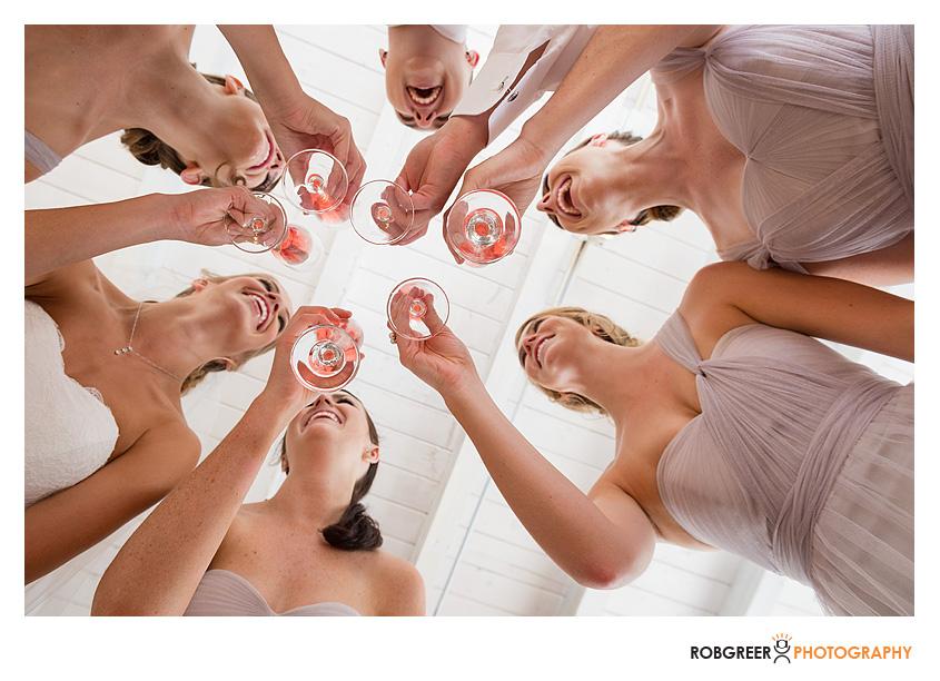 bridesmaids toasting at rancho del cielo