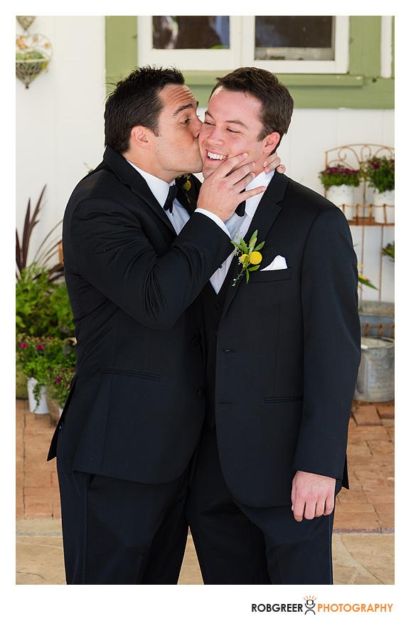 groom kisses best man