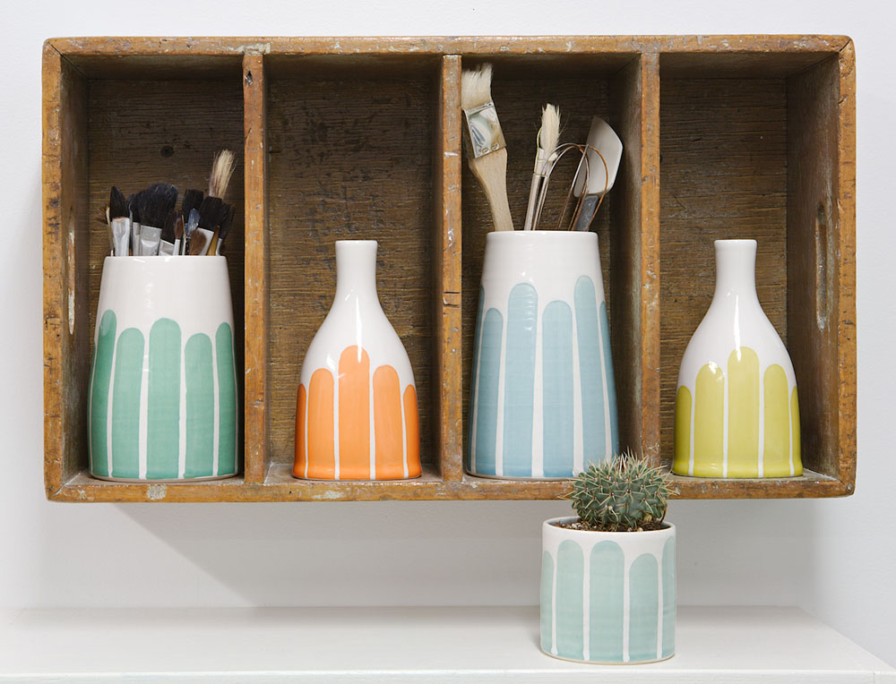 vases holding brushes studio.jpg