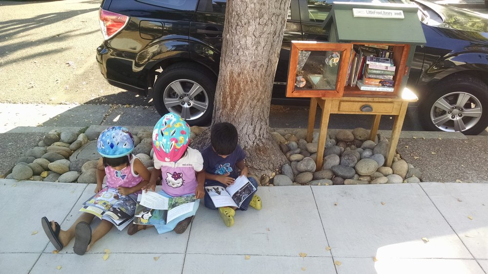 "Anywhere in the world can become a place to ""steal a reading moment."" Even during a bike ride in Alameda!"