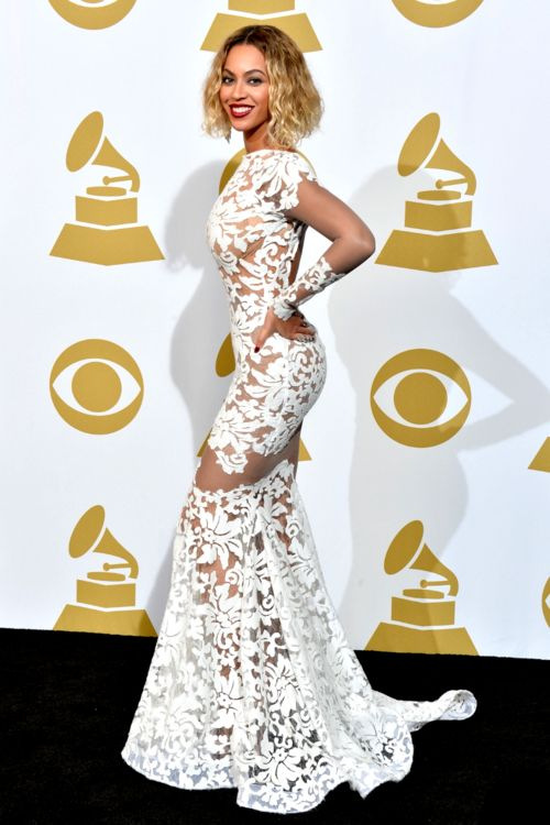Obviously Beyoncé looked fierce in this sheer white lacey gown by Project Runway alum Michael Costello