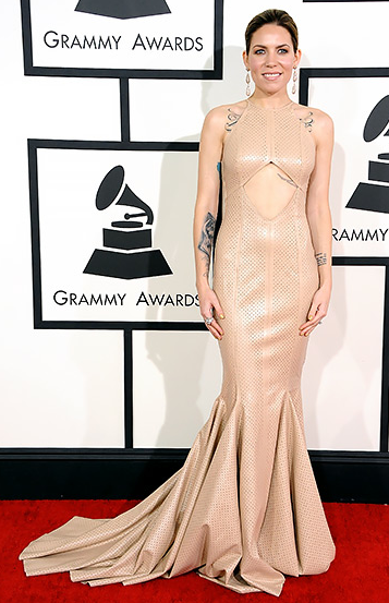 While singer/songwriter Skylar Grey received mixed reviews on her perforated leather dress by Michael Costello, I loved it! So cool.